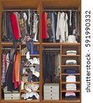 Small photo of Female cabinet in disarray, Closet in disarray, Closet in order, wardrobe, disorder, order, clothes, clothing