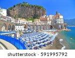 beach umbrellas aligned to the... | Shutterstock . vector #591995792