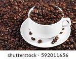 white coffee cup on pile of... | Shutterstock . vector #592011656
