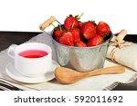 fresh red strawberry in bucket... | Shutterstock . vector #592011692