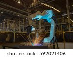 industrial robot is welding... | Shutterstock . vector #592021406