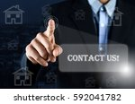 business man pointing hand on... | Shutterstock . vector #592041782