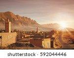 moroccan village at sunrise ...   Shutterstock . vector #592044446