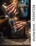 bartender making alcoholic... | Shutterstock . vector #592047236