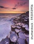 sunset over the basalt rock... | Shutterstock . vector #592053956