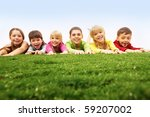 children lying on green grass | Shutterstock . vector #59207002