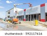 cherry picker has elevated...   Shutterstock . vector #592117616