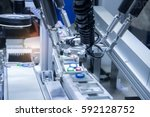 automatic robot in assembly... | Shutterstock . vector #592128752