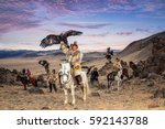 kazakh eagle hunter in... | Shutterstock . vector #592143788