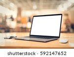 laptop with blank screen on... | Shutterstock . vector #592147652