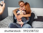happy family with newborn baby... | Shutterstock . vector #592158722