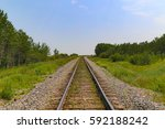 train tracks receding into the... | Shutterstock . vector #592188242