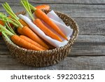 fresh baby carrots in basket on ... | Shutterstock . vector #592203215
