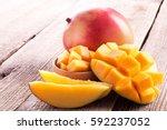 Mango And Mango Slices On A...