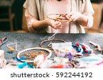 craftswoman makes dreamcatcher... | Shutterstock . vector #592244192