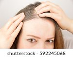 pretty woman is checking white...   Shutterstock . vector #592245068