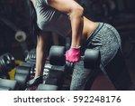 slim  bodybuilder girl  lifts... | Shutterstock . vector #592248176