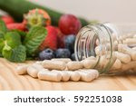 vitamins supplements in bottle... | Shutterstock . vector #592251038