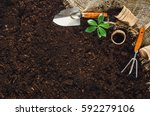 gardening tools on fertile soil ... | Shutterstock . vector #592279106