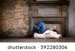 Small photo of Poor homeless man in the street with his bags