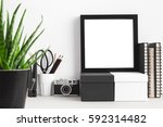 black square frame on a shelf... | Shutterstock . vector #592314482