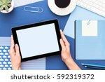 tablet in woman hands. close up. | Shutterstock . vector #592319372