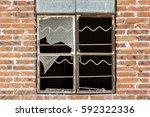 broken window on a brick wall | Shutterstock . vector #592322336