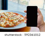 people holding a smartphone... | Shutterstock . vector #592361012