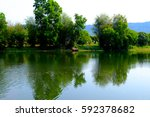 river scenery with forest...   Shutterstock . vector #592378682