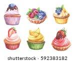 sweet cupcakes with berries ... | Shutterstock . vector #592383182
