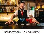 bartender behind bar counter... | Shutterstock . vector #592389092