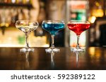 cocktails on wooden bar counter ... | Shutterstock . vector #592389122