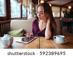 woman with tablet pc using... | Shutterstock . vector #592389695
