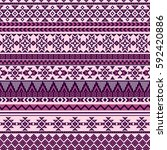 ethnic seamless pattern with... | Shutterstock .eps vector #592420886