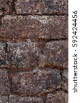 Small photo of Aged adobe brick background texture