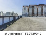 urban rooftop carpark on city... | Shutterstock . vector #592439042