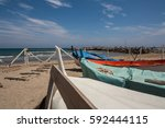 fishing  boats on the beach of... | Shutterstock . vector #592444115