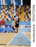 Small photo of ISTANBUL, TURKEY - DECEMBER 17, 2016: Athlete Doganur Yilmaz Triple Jumping during Turkish Athletic Federation Olympic Threshold Indoor Competitions