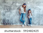 young beautiful mom with her... | Shutterstock . vector #592482425