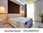 bedroom with a beautiful... | Shutterstock . vector #592485992