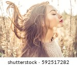 outdoor fashion photo of young... | Shutterstock . vector #592517282