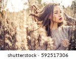 outdoor fashion photo of young... | Shutterstock . vector #592517306