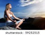 Slender Young Woman Doing Yoga...