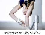 young girl gymnast exercise on... | Shutterstock . vector #592535162