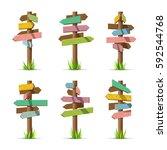 colored wooden arrow signboards ... | Shutterstock .eps vector #592544768