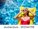 enjoying suntan and vacation....   Shutterstock . vector #592544798