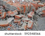 Destroyed Brick Wall Lying On...