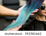 stylist demonstrates his work... | Shutterstock . vector #592581662
