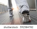 close up on running shoes.... | Shutterstock . vector #592584782