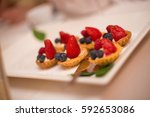 cupcakes with strawberries | Shutterstock . vector #592653086